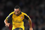 Santi Cazorla of Arsenal battles for the ball with Renato Steffen of Basel during the UEFA Champions League group A match between Arsenal FC and FC Basel 1893 at the Emirates Stadium on September 28, 2016 in London, England.
