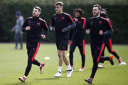Aaron Ramsey and Calum Chambers of Arsenal during an Arsenal Training Session ahead of there Europa League 2nd Leg match against AC Milan at London Colney on March 14, 2018 in St Albans, England.