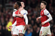 Danny Welbeck of Arsenal celebrates his penalty with Hector Bellerin and Aaron Ramsey during the UEFA Europa League Round of 16 Second Leg match between Arsenal and AC Milan at Emirates Stadium on March 15, 2018 in London, England.