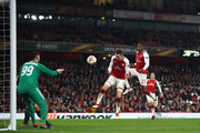 Aaron Ramsey of Arsenal heads at Gianluigi Donnarumma of AC Milan as Danny Welbeck waits to pounce on the rebound to score the third goal during the UEFA Europa League Round of 16 Second Leg match between Arsenal and AC Milan at Emirates Stadium on March 15, 2018 in London, England.