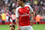Santi Cazorla of Arsenal and his child are seen after the Barclays Premier League match between Arsenal and Aston Villa at Emirates Stadium on May 15, 2016 in London, England.