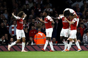 Danny Welbeck of Arsenal (obscure) celebrates after scoring his team's second goal with his team mates during the Carabao Cup Third Round match between Arsenal and Brentford at Emirates Stadium on September 26, 2018 in London, England.