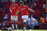 Aaron Ramsey of Arsenal warms up while wearing a 'merci Arsene' T Shirt prior to the Premier League match between Arsenal and Burnley at Emirates Stadium on May 6, 2018 in London, England.