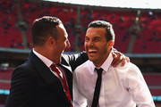 Santi Cazorla of Arsenal and Pedro of Chelsea embrace on the pitch prior to the Emirates FA Cup Final between Arsenal and Chelsea at Wembley Stadium on May 27, 2017 in London, England.