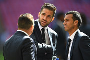 Santi Cazorla of Arsenal speaks to Chelsea duo Cesc Fabregas of Chelsea and Pedro of Chelsea on the pitch prior to the Emirates FA Cup Final between Arsenal and Chelsea at Wembley Stadium on May 27, 2017 in London, England.