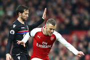 Jack Wilshere of Arsenal is challenged by Yohan Cabaye of Crystal Palace during the Premier League match between Arsenal and Crystal Palace at Emirates Stadium on January 20, 2018 in London, England.