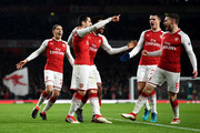 Aaron Ramsey of Arsenal celebrates after scoring his sides first goal with teammates  during the Premier League match between Arsenal and Everton at Emirates Stadium on February 3, 2018 in London, England.