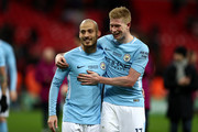 David Silva and Kevin De Bruyne of Manchester City celebrate after the Carabao Cup Final between Arsenal and Manchester City at Wembley Stadium on February 25, 2018 in London, England.