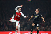 Aaron Ramsey of Arsenal in action with Ander Herrera of Manchester United during the Premier League match between Arsenal and Manchester United at Emirates Stadium on December 2, 2017 in London, England.
