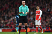 Referee Mike Dean reacts during the Premier League match between Arsenal and Middlesbrough at Emirates Stadium on October 22, 2016 in London, England.