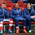 Theo Walcott Alex Oxlade-Chamberlain Photos - (L-R) Alex Oxlade-Chamberlain, Theo Walcott and Wojciech Szczesny of Arsenal look on from the substitutes bench  during the UEFA Champions League round of 16, first leg match between Arsenal and Monaco at The Emirates Stadium on February 25, 2015 in London, United Kingdom. - Arsenal v AS Monaco FC