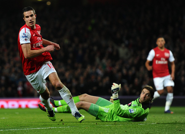 Robin van Persie of Arsenal celebrates scoring their first goal during the Barclays Premier League match between Arsenal and Newcastle United at Emirates Stadium on March 12, 2012 in London, England.