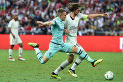 Aaron Ramsey of Arsenal challenges Adrien Rabiot of Paris Saint Germain for the ball during the International Champions Cup match between Arsenal and Paris Saint Germain at the National Stadium on July 28, 2018 in Singapore.