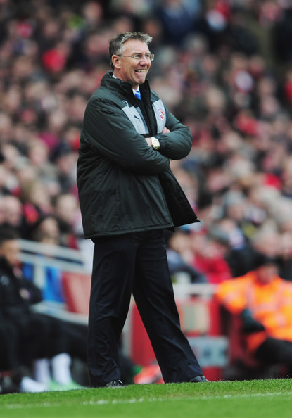 Nigel Adkins manager of Reading looks thoughtful during the Barclays Premier League match between Arsenal and Reading at Emirates Stadium on March 30, 2013 in London, England.