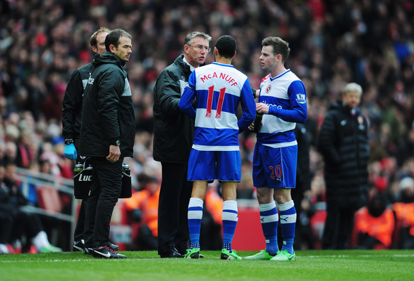 Nigel Adkins manager of Reading talks to Jobi McAnuff (11) and Danny Guthrie of Reading during the Barclays Premier League match between Arsenal and Reading at Emirates Stadium on March 30, 2013 in London, England.