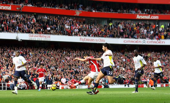 Cesc Fabregas Cesc Fabregas of Arsenal scores the second goal during the Barclays Premier League match between Arsenal and Tottenham Hotspur at the Emirates Stadium on October 31, 2009 in London, England.