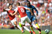Hector Bellerin of Arsenal, Aaron Ramsey of Arsenal and Arthur Masuaku of West Ham United battle for posession during the Premier League match between Arsenal FC and West Ham United at Emirates Stadium on August 25, 2018 in London, United Kingdom.