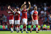 Aaron Ramsey of Arsenal shows appreciation to the fans following during the Premier League match between Arsenal and West Ham United at Emirates Stadium on April 22, 2018 in London, England.