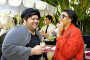 Actor Harvey Guillen (L) and actress Kiersey Clemons attend the Art For Amnesty Pre-Golden Globes Recognition Brunch at Chateau Marmont on January 8, 2016 in Los Angeles, California.