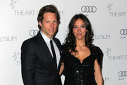 """Actors Jamie Bamber (L) and Kerry Norton attend the Art of Elysium's 6th Annual Black-tie Gala """"Heaven"""" at 2nd Street Tunnel on January 12, 2013 in Los Angeles, California."""