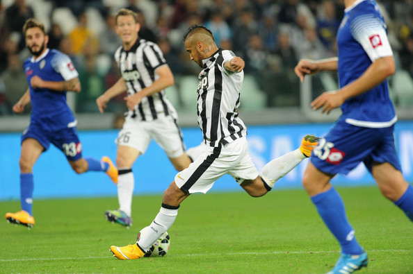 Arturo Vidal Arturo Vidal of Juventus FC shoot the ball of the goal of 2-0 during the Serie A match between Juventus FC and AC Cesena at Juventus Arena on September 24, 2014 in Turin, Italy.