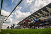 Paul Hanagan riding Adhwaa (R) to win Spinal Injuries Association EBF Stallions Stakes at Ascot racecourse on April 30, 2014 in Ascot, England.