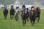 Donnacha O'Brien riding Kew Gardens (purple/white) win The Qipco British Champions Long Distance Cup from Frankie Dettori and Stradivarius (yellow cap) during the QIPCO British Champions Day at Ascot Racecourse on October 19, 2019 in Ascot, England.