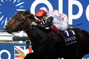 Frankie Dettori riding Star Catcher (red cap) win The Qipco British Champions Fillies & Mares Stakes from Delphinia and Seamie Heffernan (pink) during the QIPCO British Champions Day at Ascot Racecourse on October 19, 2019 in Ascot, England.