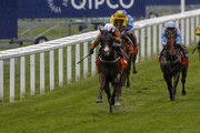 Paul Hanagan riding Stamp Hill (L, white cap) win The Gigaset International Stakes at Ascot racecourse on July 29, 2017 in Ascot, England.