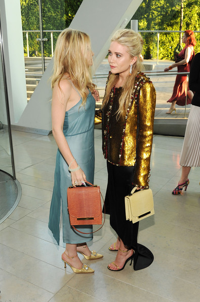 Ashley Olsen Ashley Olsen (L) and Mary-Kate Olsen attend the 2011 CFDA Fashion Awards at Alice Tully Hall, Lincoln Center on June 6, 2011 in New York City.