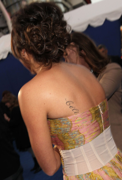 Ashley Tisdale Actress Ashley Tisdale (tattoo detail) arrives at the