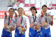 Youri Kim, Hyunji Kim, Ahreum Na and Jumi Lee of Korea celebrate on the podium after winning the Cycling Track Women's Team Final on day ten of the Asian Games on August 28, 2018 in Jakarta, Indonesia.