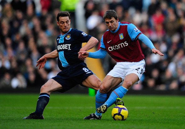 Stephen Warnock Stephen Warnock of Aston Villa battles with Scott Parker of