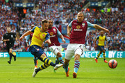 Aaron Ramsey of Arsenal shoots past Ron Vlaar of Aston Villa during the FA Cup Final between Aston Villa and Arsenal at Wembley Stadium on May 30, 2015 in London, England.