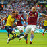 Ron Vlaar Photos - Aaron Ramsey of Arsenal shoots past Ron Vlaar of Aston Villa during the FA Cup Final between Aston Villa and Arsenal at Wembley Stadium on May 30, 2015 in London, England. - Aston Villa v Arsenal - FA Cup Final