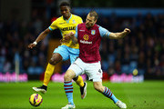 Wilfried Zaha of Crystal Palace and Ron Vlaar of Aston Villa battle for the ball during the Barclays Premier League match between Aston Villa and Crystal Palace at Villa Park on January 1, 2015 in Birmingham, England.