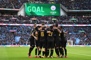 Manchester City players celebrate the first goal scored by Sergio Aguero of Manchester City during the Carabao Cup Final between Aston Villa and Manchester City at Wembley Stadium on March 01, 2020 in London, England.