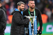 Sergio Aguero and Nicolas Otamendi of Manchester City pose with the trophy following their sides victory in the Carabao Cup Final between Aston Villa and Manchester City at Wembley Stadium on March 01, 2020 in London, England.