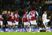 Ron Vlaar and Jores Okore of Aston Villa appeal to Referee  Lee Mason as Ashley Young of Manchester United lies on the pitch after a challenge from Gabriel Agbonlahor of Aston Villa during the Barclays Premier League match between Aston Villa and Manchester United at Villa Park on December 20, 2014 in Birmingham, England.