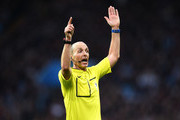 Referee, Mike Dean gestures during the Barclays Premier League match between Aston Villa and West Ham United at Villa Park on December 26, 2015 in Birmingham, England.
