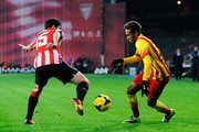 Neymar of FC Barcelona duels for the ball with Andoni Iraola of Athletic Club during the La Liga match between Athletic Club and FC Barcelona at San Mames Stadium on December 1, 2013 in Bilbao, Spain.