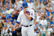 Jon Lester #34 of the Chicago Cubs reacts after giving up a two run home run to Freddie Freeman #5 of the Atlanta Braves batting practice during the third inning at Wrigley Field on September 2, 2017 in Chicago, Illinois.