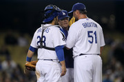Pitching coach Rick Honeycutt (C) of the Los Angeles Dodgers meets with pitcher Jonathan Broxton #51 and catcher Rod Barajas #28 during a ninth inning rally by the Atlanta Braves on April 18, 2011 at Dodger Stadium in Los Angeles, California.  The Dodgers won 4-2.