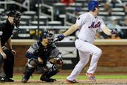 Jay Bruce #19 of the New York Mets hits an RBI single in the third inning as Kurt Suzuki #24 of the Atlanta Braves defends on September 25,2018 at Citi Field in the Flushing neighborhood of the Queens borough of New York City.