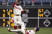 Tyler Goeddel #2 of the Philadelphia Phillies flips the ball to Andres Blanco #4 after making a sliding catch against the Atlanta Braves at Citizens Bank Park on May 21, 2016 in Philadelphia, Pennsylvania. The Braves defeated the Phillies 2-0.