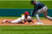 Kolten Wong #16 of the St. Louis Cardinals dives back to first base against Freddie Freeman #5 of the Atlanta Braves in the third inning at Busch Stadium on July 1, 2018 in St. Louis, Missouri.