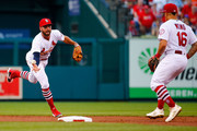 Greg Garcia #35 of the St. Louis Cardinals flips the ball to Kolten Wong #16 of the St. Louis Cardinals for a double play against the Atlanta Braves in the second inning at Busch Stadium on June 29, 2018 in St. Louis, Missouri.