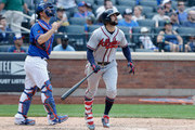 Nick Markakis #22 of the Atlanta Braves watches the flight of his tenth inning home run along with Devin Mesoraco #29 of the New York Mets at Citi Field on August 5, 2018 in the Flushing neighborhood of the Queens borough of New York City.
