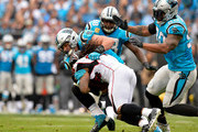 Luke Kuechly #59 of the Carolina Panthers tackles Derrick Coleman #40 of the Atlanta Falcons in the third quarter during their game at Bank of America Stadium on November 5, 2017 in Charlotte, North Carolina.