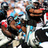 DeAngelo Williams #34 of the Carolina Panthers is tackled into the defense of the Atlanta Falcons during their game at Bank of America Stadium on November 15, 2009 in Charlotte, North Carolina.